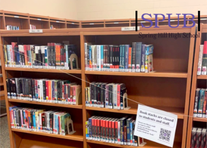 """Although checking a book out this year may look different, it is still just as easy. """"Book stacks are closed to students and staff"""" as the paper says, so you must request a book title  to the library staff or use the bookhub form to put a book on hold (photo by M. Putnam)."""