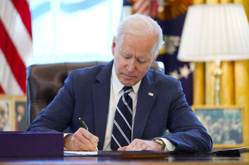 President Joe Biden signed the American Relief Plan into law on March 11. He then delivered his first primetime address, outlining his hopes for bringing the pandemic to an end in the U.S. (photo courtesy AP News).
