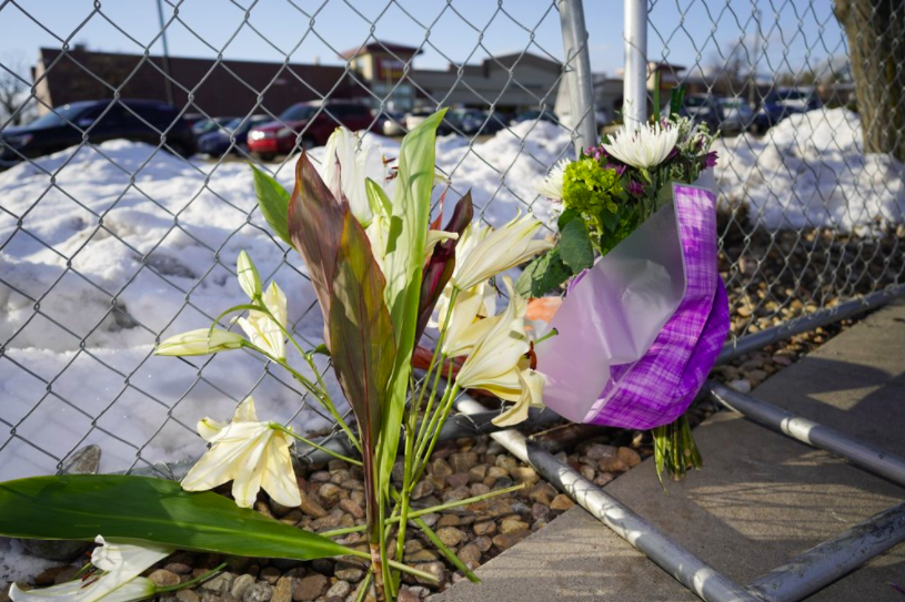 Flowers are placed on a makeshift barrier surrounding a grocery store in Boulder, Colo. where 10 people were killed on Monday. The shooter is currently being treated at a nearby hospital, but a motive has not yet been established (photo courtesy AP News).