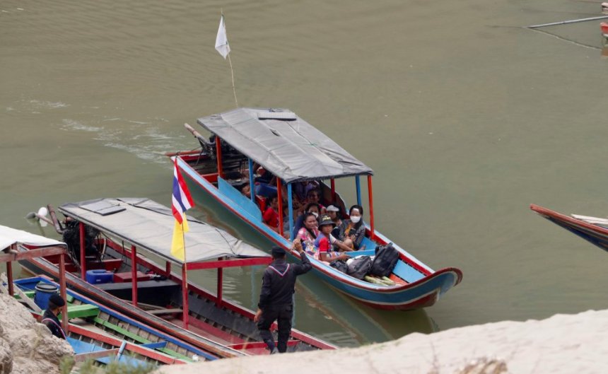 Karenni refugees from Myanmar arrive in northern Thailand, seeking help for an injured person they had on their boat. Recently, Thailand has begun forcing out some of the thousands of Burmese refugees, but the Prime Minister says that they have not forced anyone to leave (photo courtesy AP News).