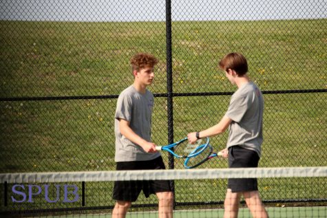 Carson Lightcap, 10, and Tom Uferman, 12, touch rackets. Touching rackets is an act of encouragement in Tennis (Photo by B. Shaffer).