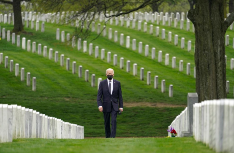 President Joe Biden walks through Arlington National Cemetery. President Biden recently announced plans to withdraw all remaining American troops from Afghanistan (photo courtesy AP News).