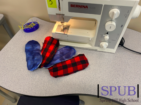The Apparel Productions class is hard at work making washable, reusable menstrual pads for girls in Africa who do not have access to the products they need (photo credit T. Dent).