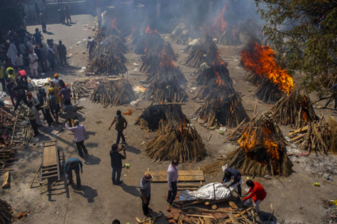 As deaths due to COVID-19 continue to rise in India, the country has found itself having to utilize funeral pyres like the ones pictured here to dispose of their dead (photo courtesy AP News).