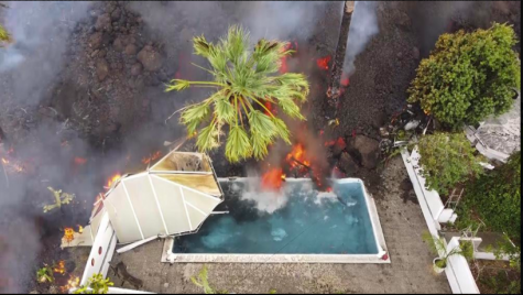 A swimming pool in Spain gets flooded with lava from the volcanic eruption (Photo Courtesy AP News).